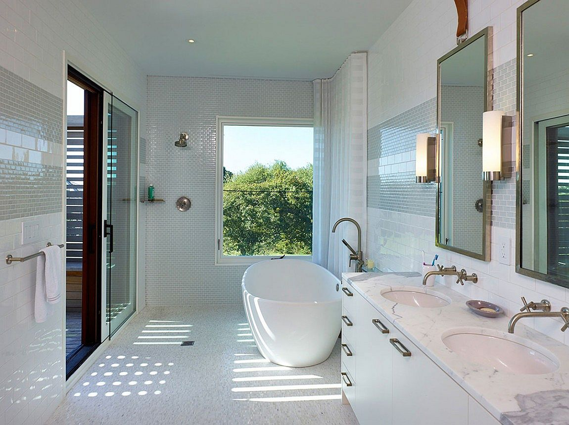Contemporary bathroom with standalone bathtub and marble countertop