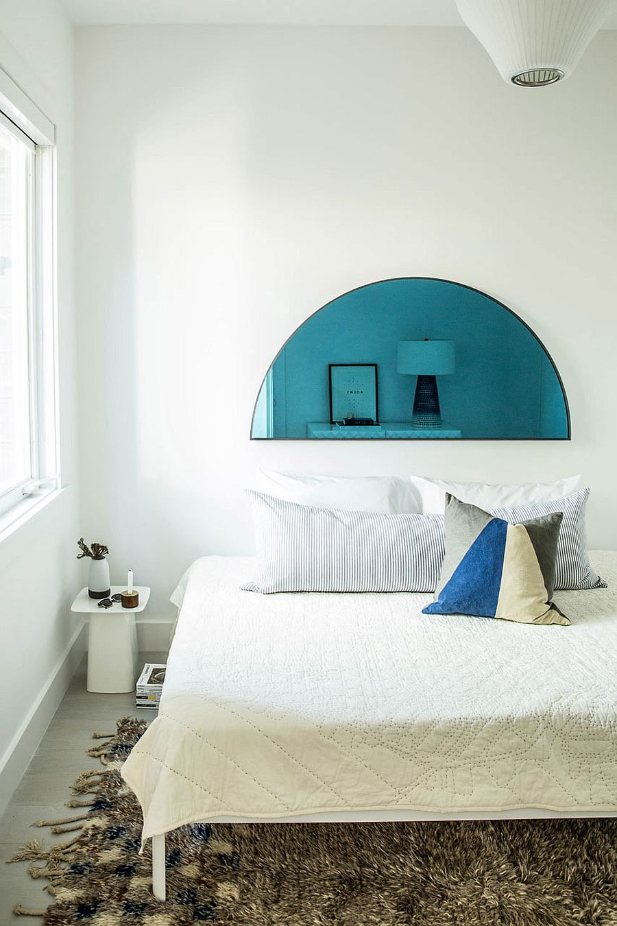 Contemporary bedroom in white with a hint of blue