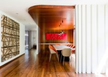 Curved false ceiling design demarcates the dining space in the open floor plan
