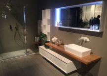 Custom-bathroom-deisgn-by-Puntotre-with-sleek-contemporary-vanity-217x155
