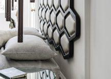 Custom headboard of the bed brings hexagonal style to the bedroom