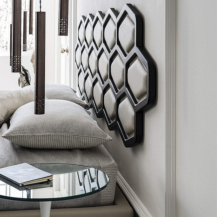 Custom headboard of the bed brings hexagonal style to the bedroom