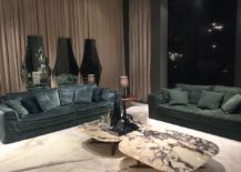 Custom mirrors in the backdrop and coffee tables with marble top also add to the refined living room design - Alberta Salotti at Milan 2016