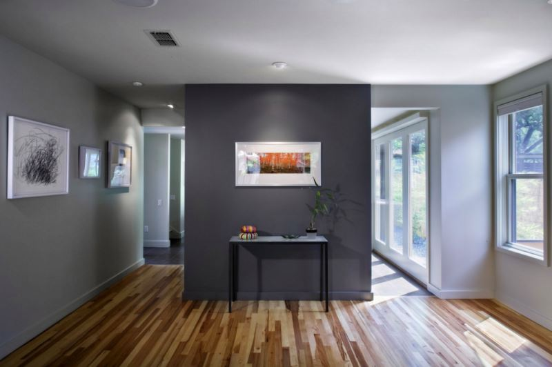 Dark grey accent wall in a grey room