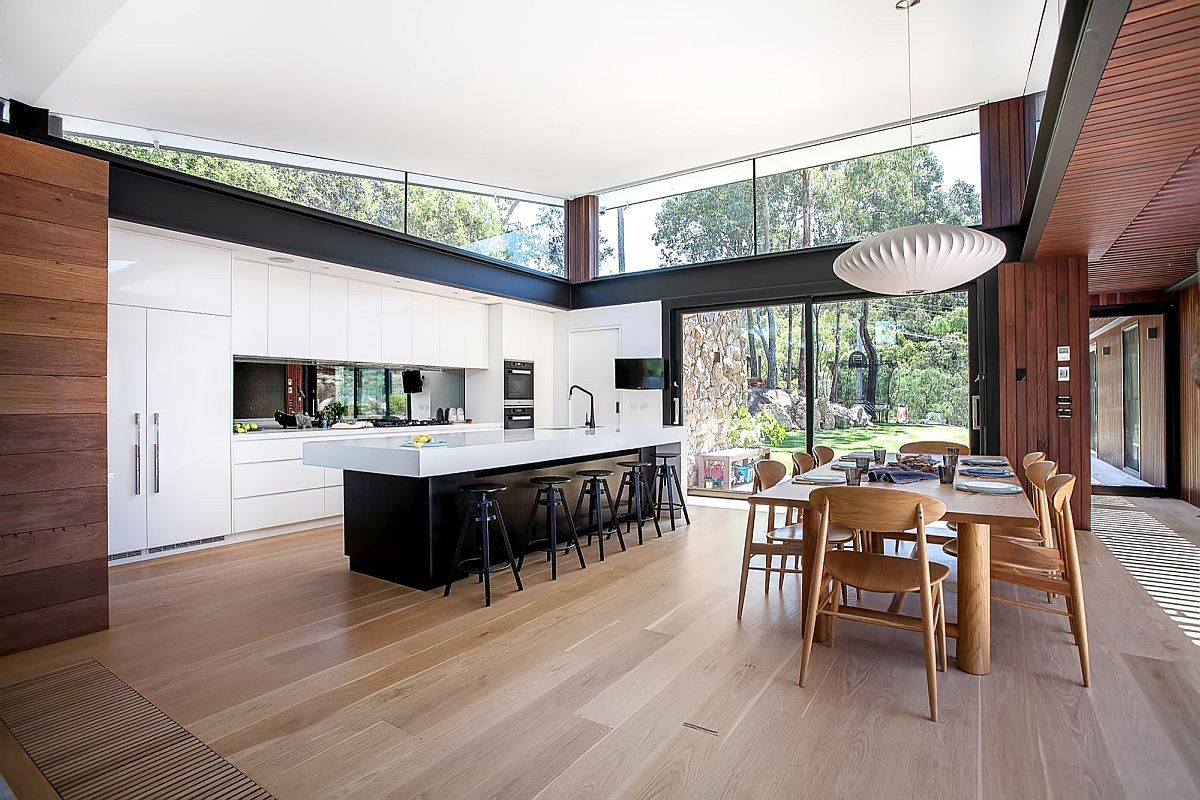 Dark kitchen island with a white countertop is a showstopper