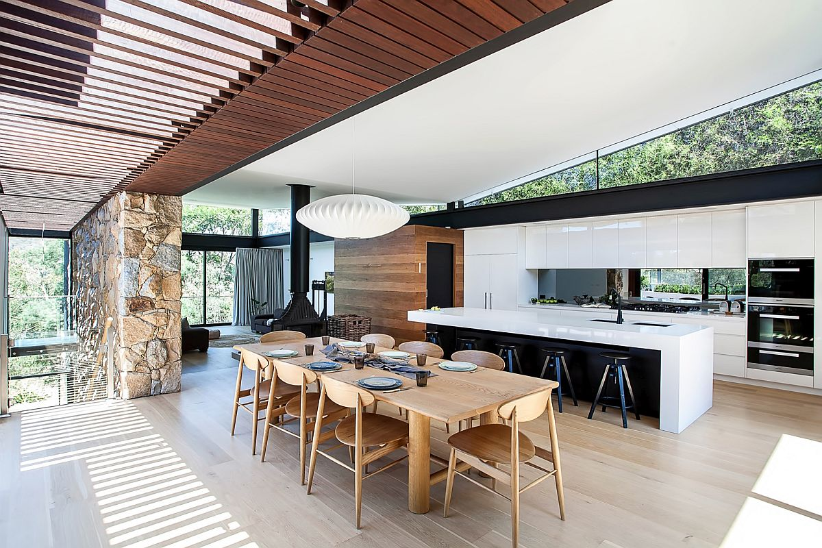 Dining Room Adds Warmth Of Wood To The Stone And Glass Home