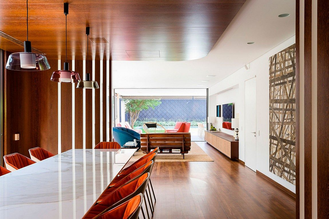 Dining room and living area of modern Brazilian home
