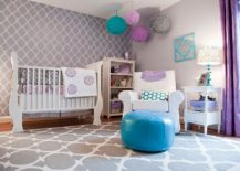 Drapes bring a dash of purple to this modern nursery in gray
