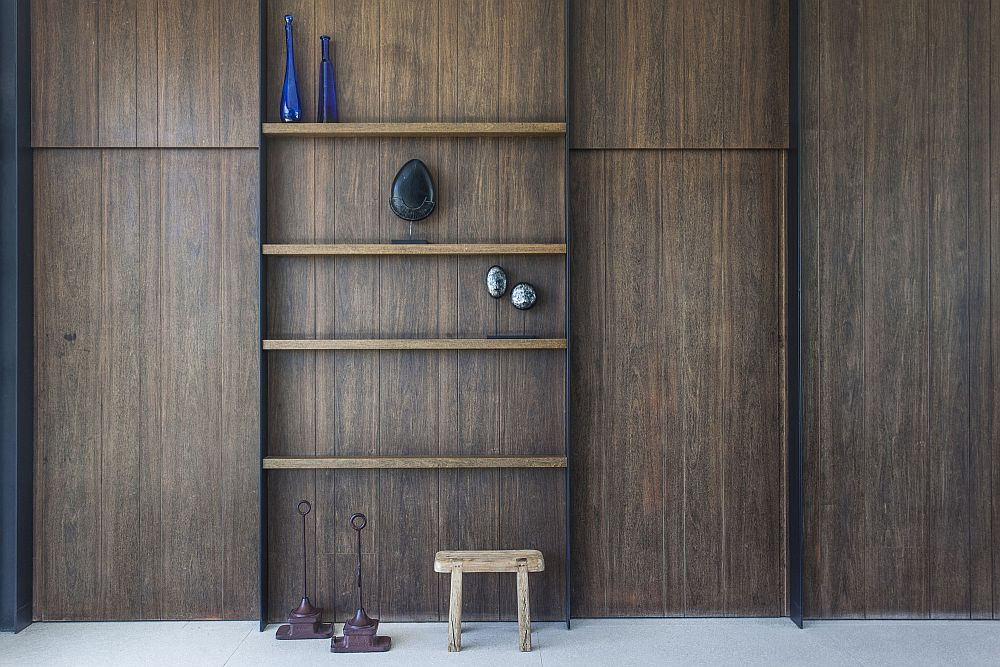 Dyed walnut and sanded lapacho shelves inside the home