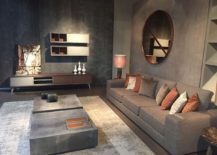 Elegant sofa and coffee tables in gray have a smart industrial vibe