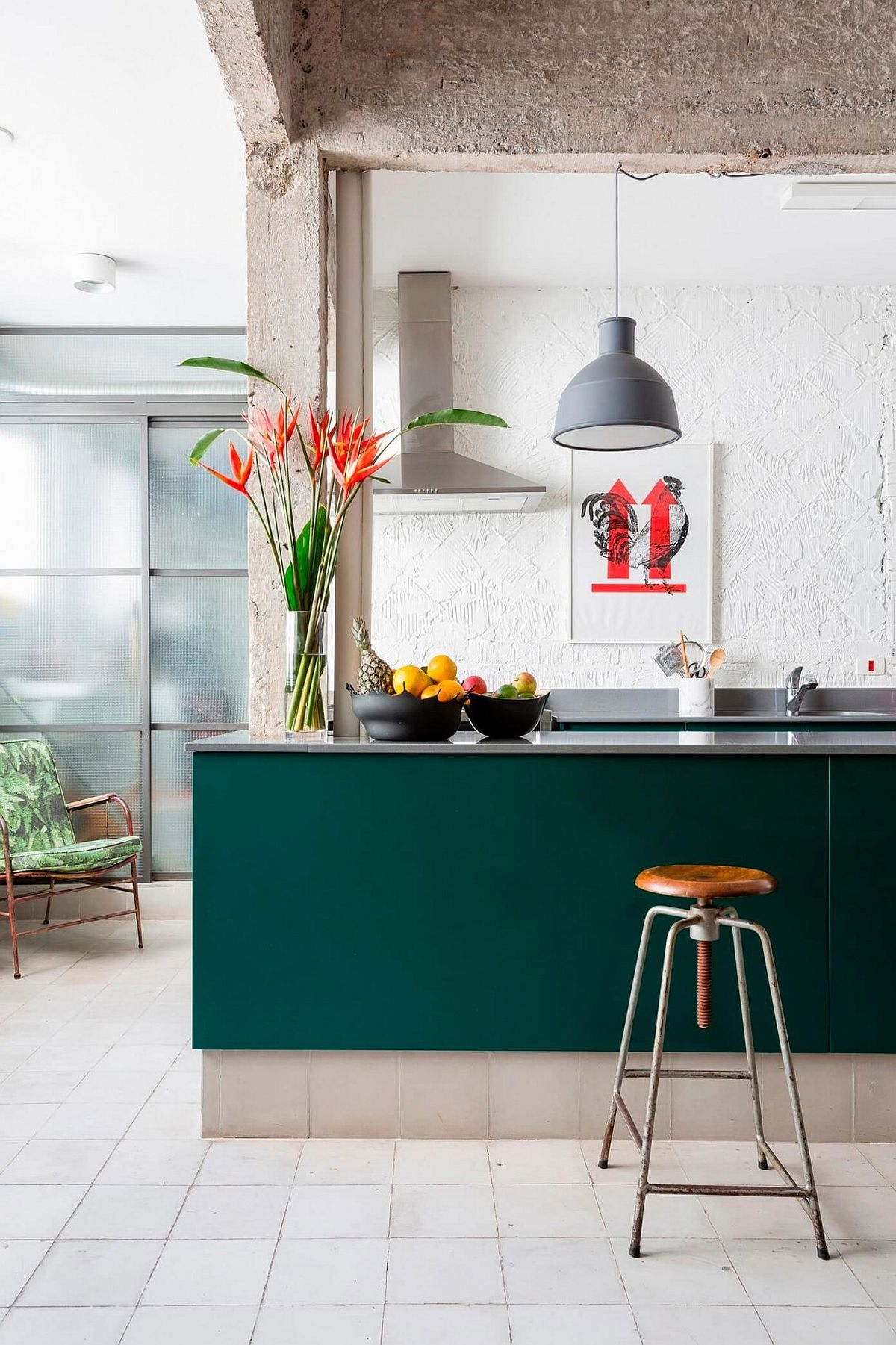 Exposed cement beams, textured kitchen backsplash and a colorful kitchen island for the Sao Paulo home