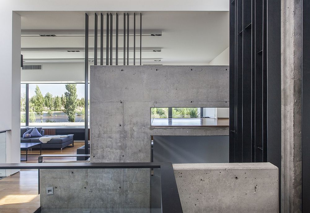 Exposed concrete walls add a fun element to the interior
