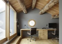 Exposed timber beams give the attic home office a great and unique ambiance