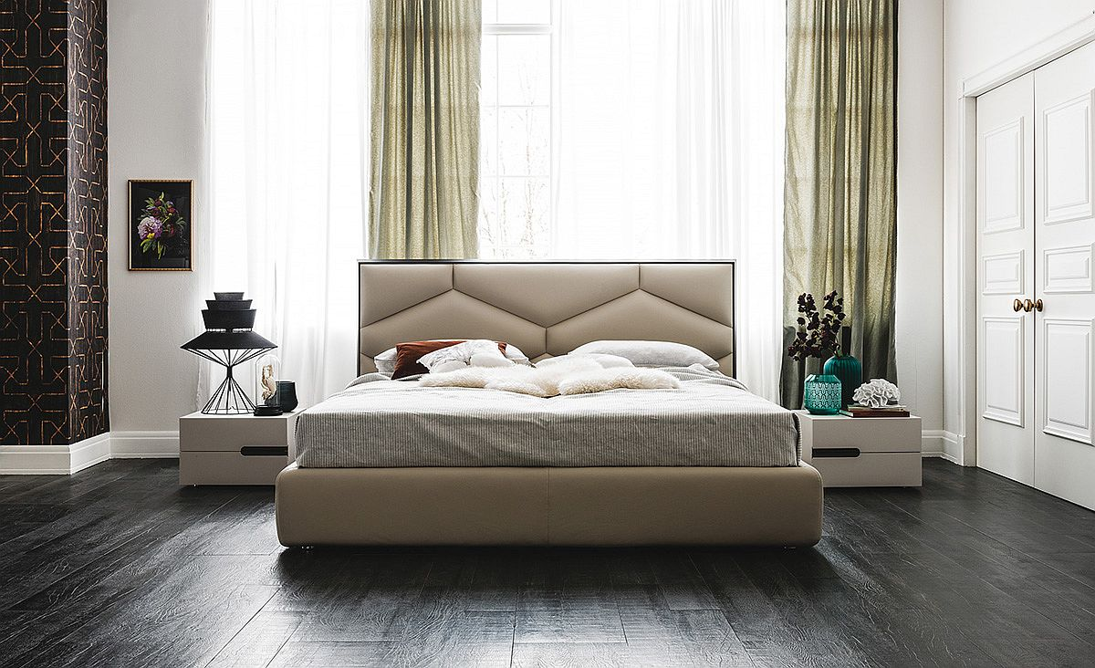 Exquisite bed frame exudes luxury thanks to the plush headboard