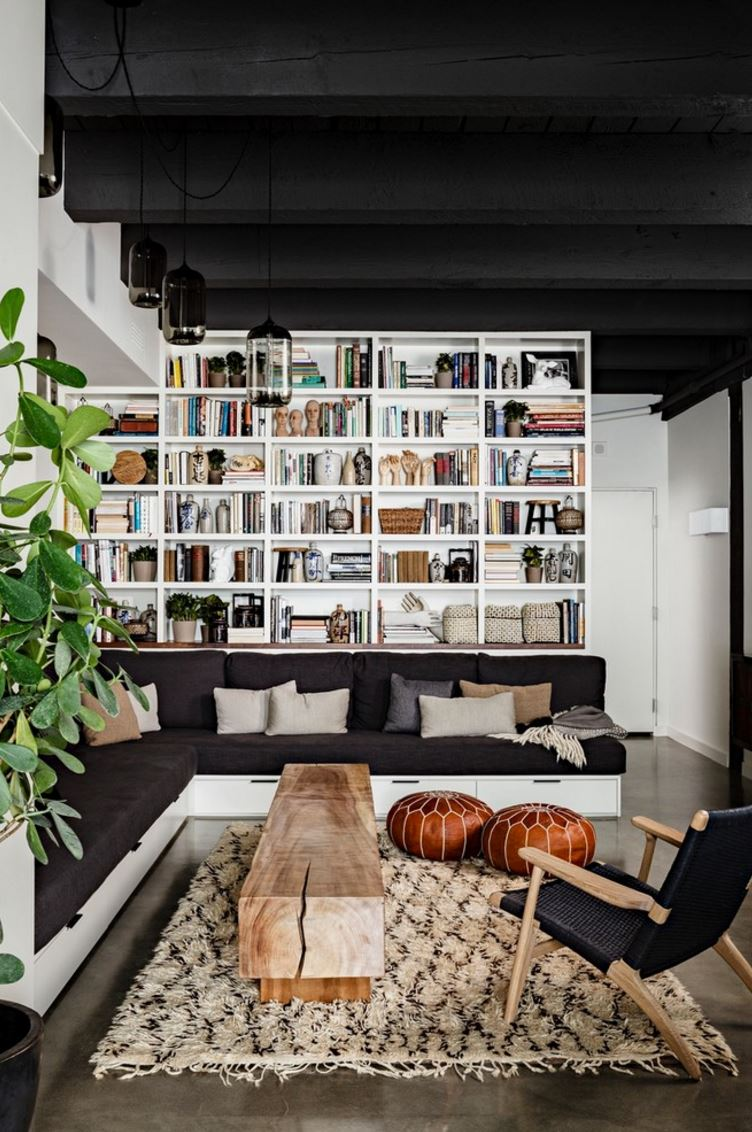 Extra pouf seating in a modern eclectic interior