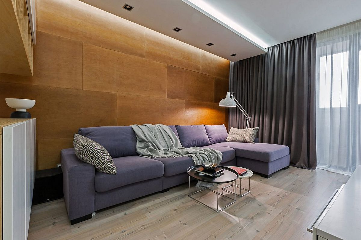 Fabulous wooden wall adds textural beauty to the contemporary living space