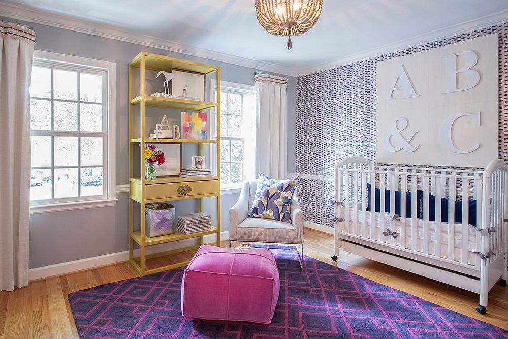 Fashionable nursery with wonderful use of wallpaper and a dash of pink [Design: Lucy and Company / Photography by Mekenzie Loli]