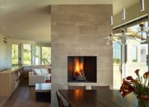 Fireplace-delineates-the-dining-space-from-the-living-room-217x155