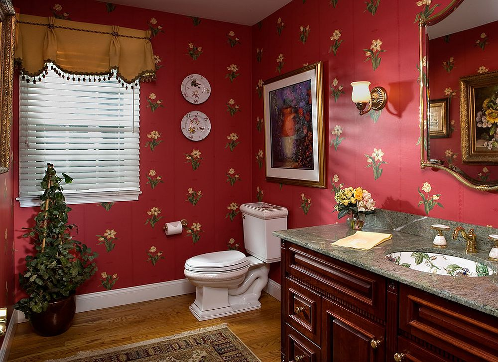 Flowery wallpaper with lots of red is perfect for the classic and playful Victorian powder room [Design: Diane Burgoyne Interiors / Photography by Tim Proctor]