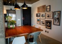 Framed artwork in the dining room adds fun and playfulness to the setting