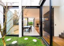 Glazed walkway and glass extension give the classic home a modern vibe