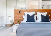 Headboard acts as a visual partition in this relaxing bedroom