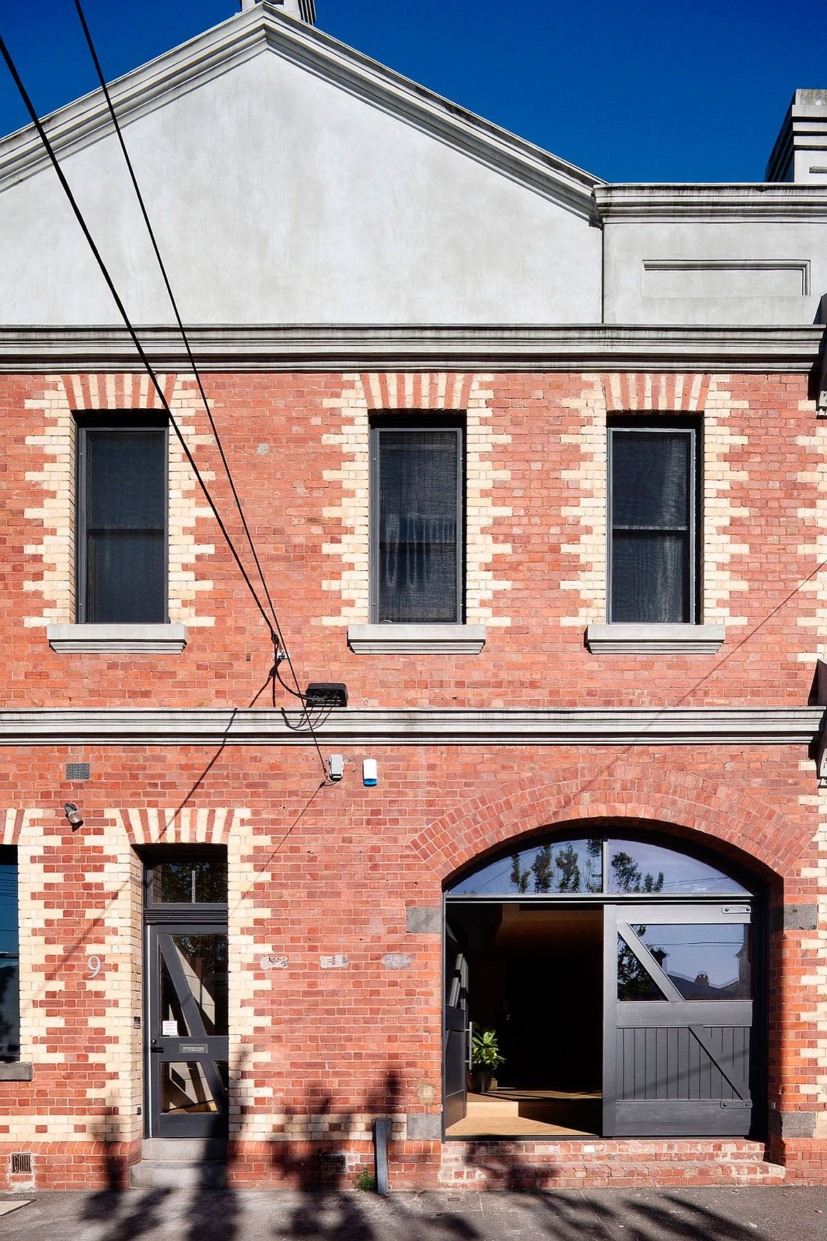 Heritage exterior of 19th century industrial warehouse turned into modern home in North Fitzroy