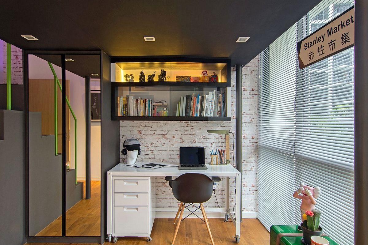Home office with loft space above and workdesk on wheels