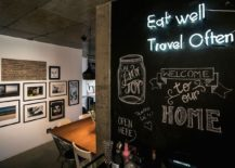 Iluminated wall sign and chalkboard wall in the Brazilian apartment