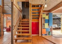Ingenious bookshelf design with colorful sliding panels