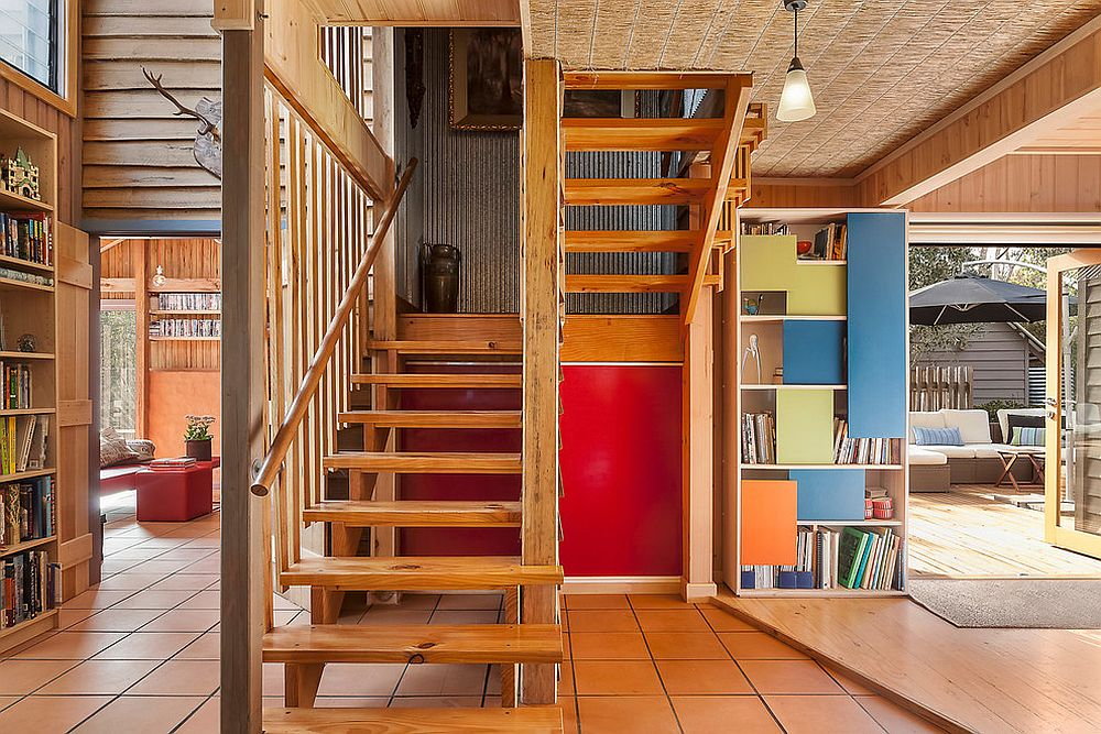 Ingenious bookshelf design with colorful sliding panels