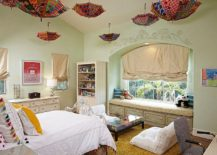 Ingenious use of colorful umbrellas as decorative pieces in the kids' room