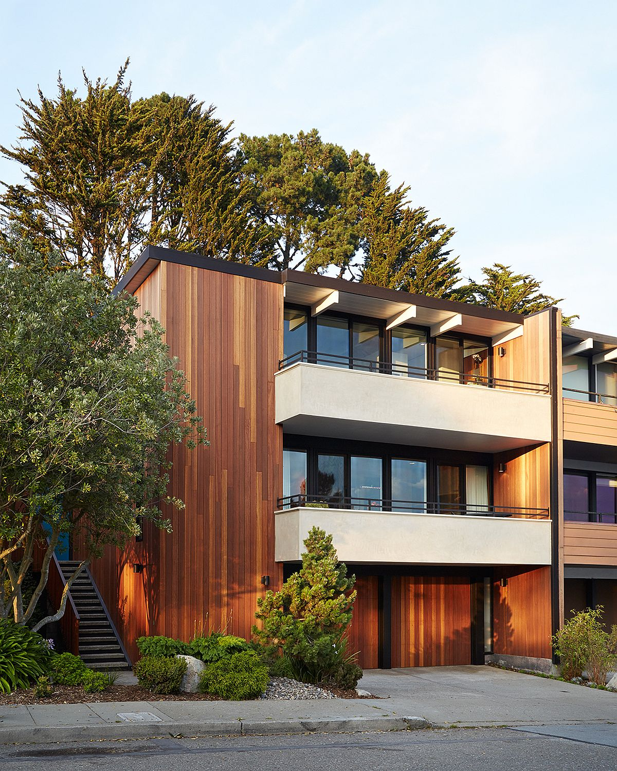 Kayu Batu wood siding is used to revitalize and give the classic Eichler Residence a new look White and Mahogany Palette Revitalizes 1962 Eichler Home in San Francisco