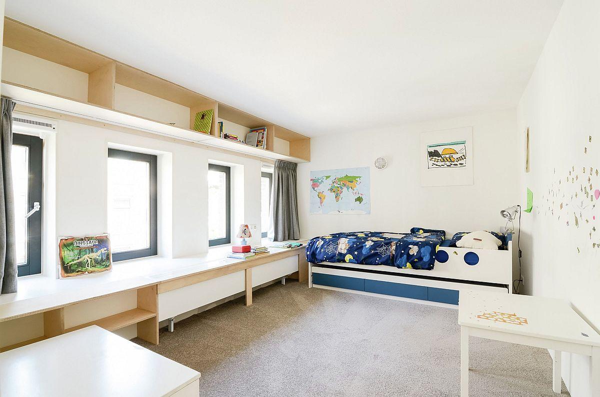 Kids' bedroom with large window seat