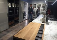 Kitchen sialnd with marble worktop and wood serving station