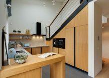 Kitchen with Hexagonal tiled backsplash and wooden shelves