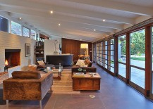Large glass windows connect the living area with the outdoors