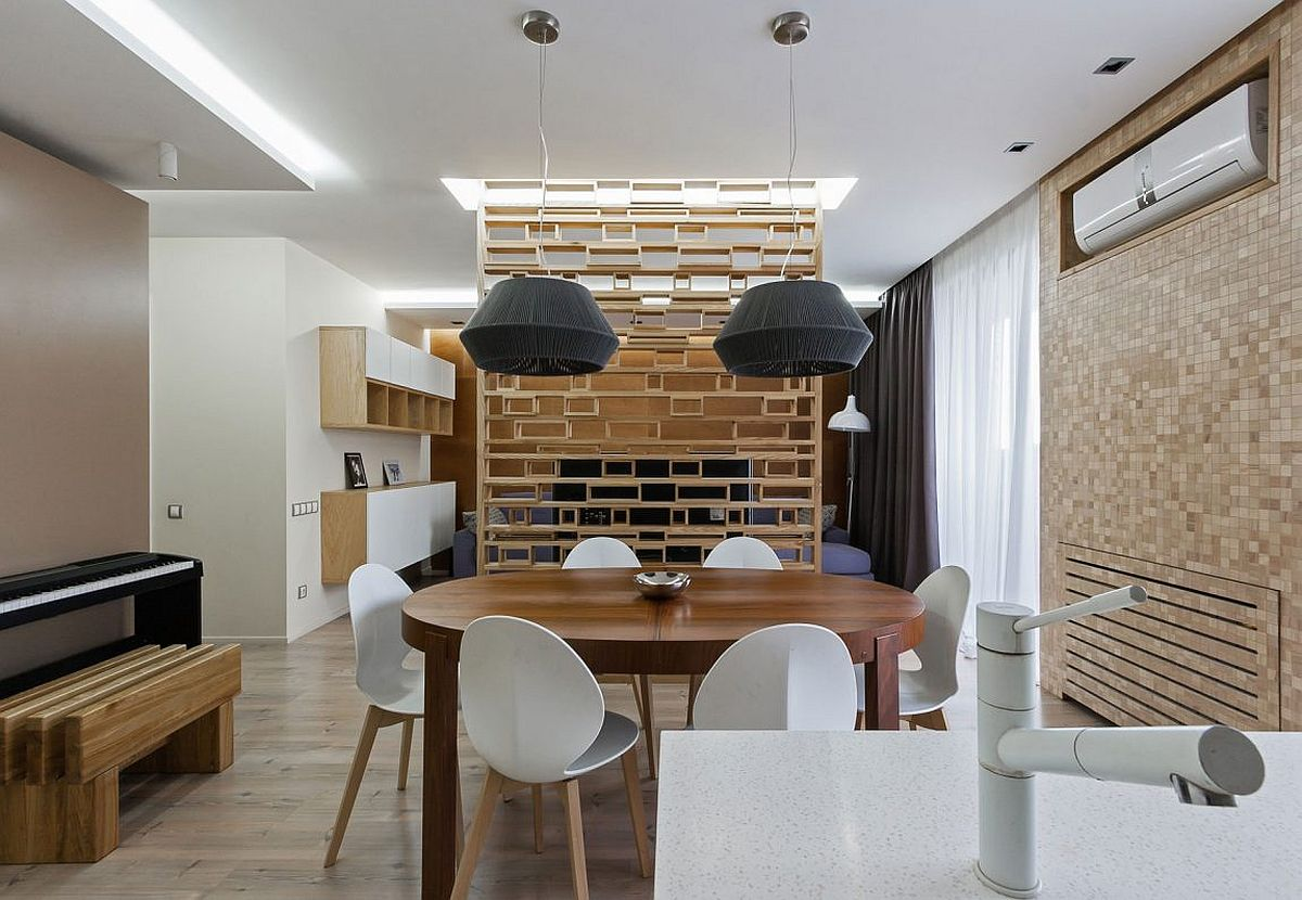 Large pendant lights complement the style and form of the dining table