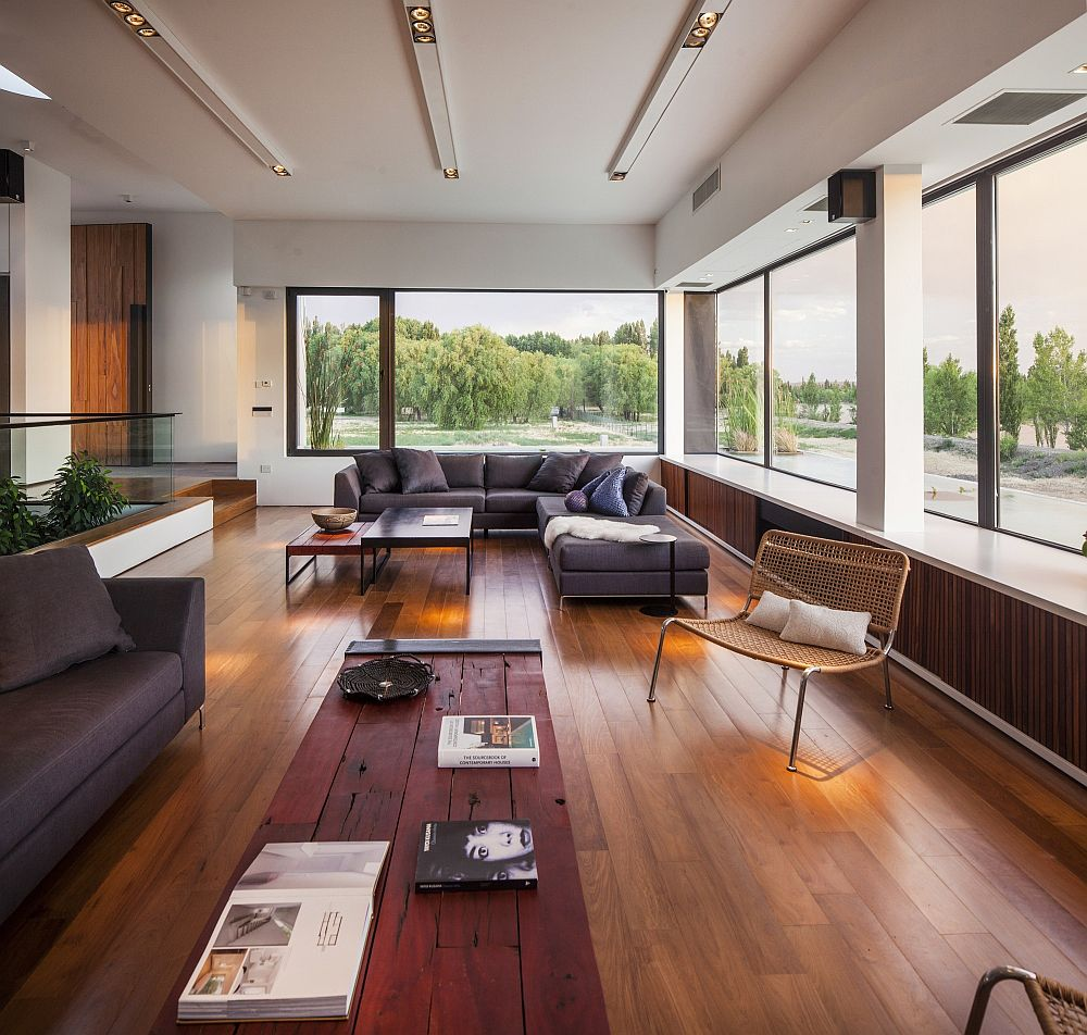 Large windows in the living room offer a view of the river outside