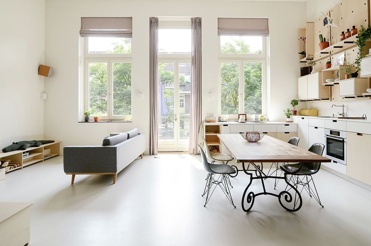 Living area and dining space of the school converted into modern apartments in Amsterdam