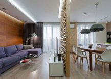 Living area visually separated from the kitchen and dining using plywood partition