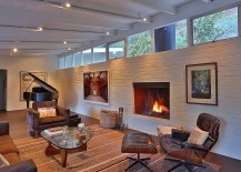 Living room brick wall painted white with a fireplace