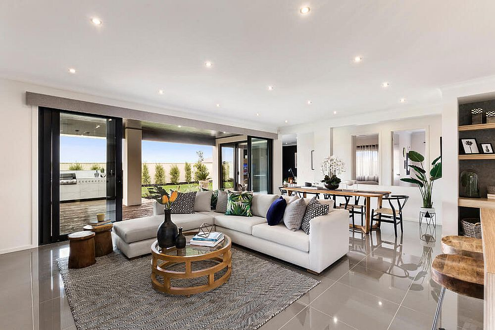 Living room with lovely ambient lighting, sparkling floor and a sectional in white