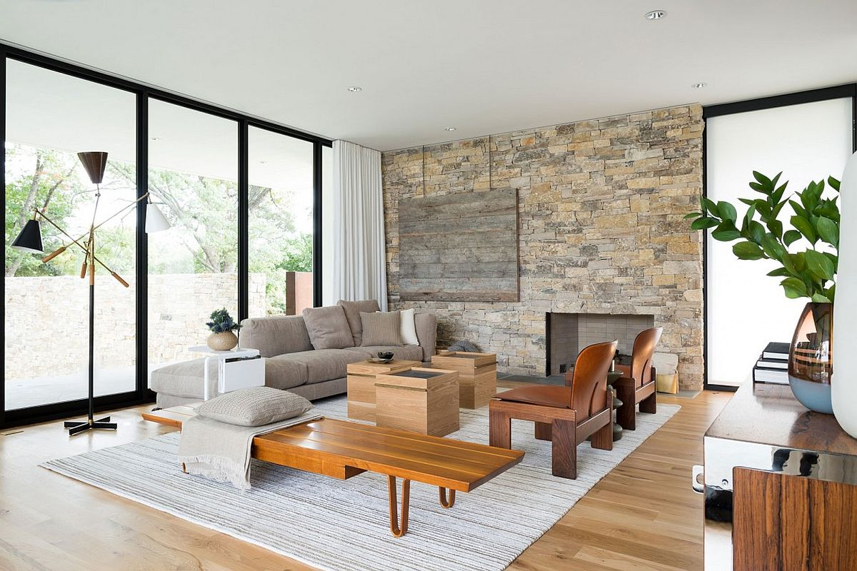 Living room with stone accent wall and stylish decor