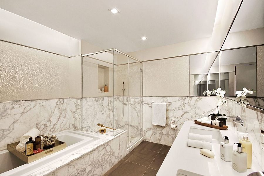 Luxurious master bathroom of opulent NYC apartment clad in marble