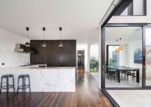 Marble kitchen island and backsplash give the interior a vibe of luxury
