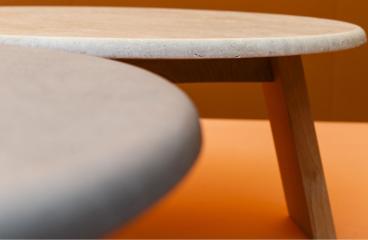 The Maya side table, designed by Lars Beller Fjetland, combines stone and wood. Image via Domus.