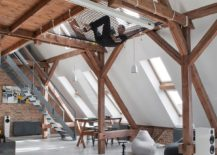 Mezzanine level of the attic apartment with relaxing hammock