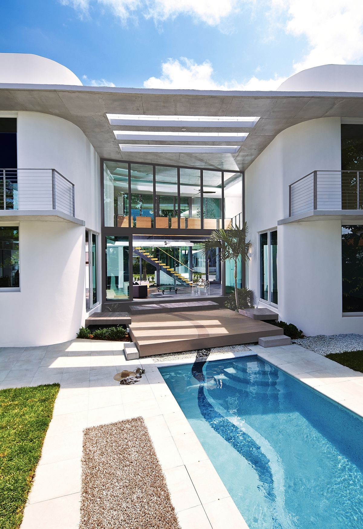 Miami's unique culture, MIMO style and heritage shape the contemporary residence with expansive backyard