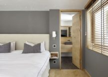 Modern bedroom in gray with light oak accents